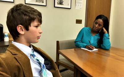 Harry Roussel of Sag Harbor, left, spoke about dyslexia with an aide to New York State Assemblywoman Catherine Nolan, who represents a district in Queens.
