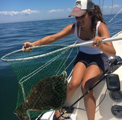 Anni Spacek, 13, caught a nine-pound fluke by the Shagwong buoy this week.