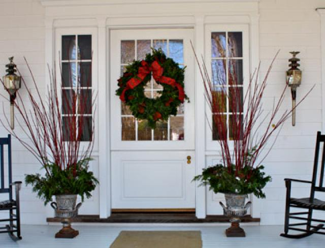 The simplicity of the front porch decorations offers a hint of the festive yet restrained approach throughout the house.