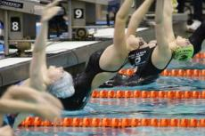 Julia Brierley, arching at the start of the 100-yard backstroke above, placed second in that event and second in the 100 breaststroke. She will compete in the Y.M.C.A. national meet in Greensboro, N.C., next month.