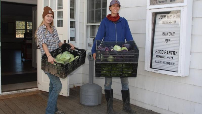 Melissa Mapes, left, and Jess Tonn of Share the Harvest Farm drop off vegetables at the Springs Food Pantry.